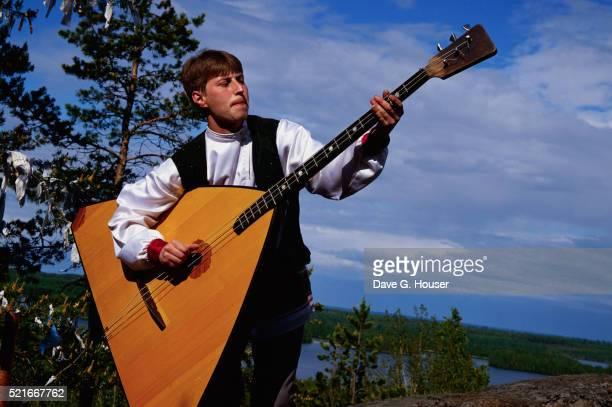 Folk Musician Playing a Balalaika