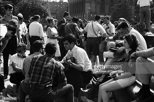 Folk musicians and folk music enthusiasts gather in June 1962 in Greenwich Village's Washington Square Park in New York City New York
