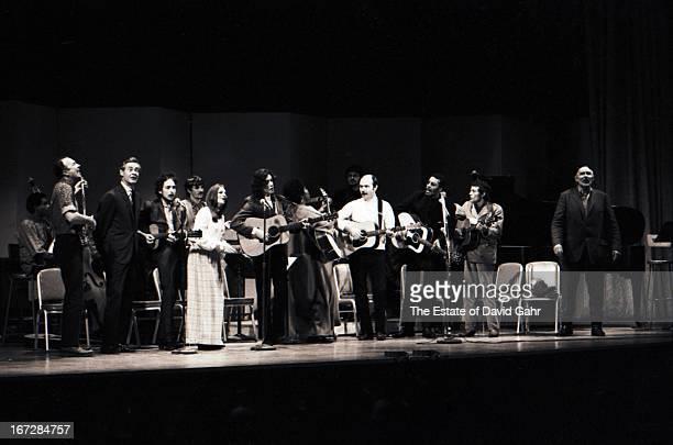 Folk musicians including bassist and composer Bill Lee folk singer Pete Seeger actor Robert Ryan singer songwriter Bob Dylan musician Rick Danko of...