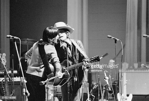 Folk musicians Joan Baez and Bob Dylan perform at Clinton State Prison before some 250 prisoners for a benefit concert for Rubin 'Hurricane' Carter...