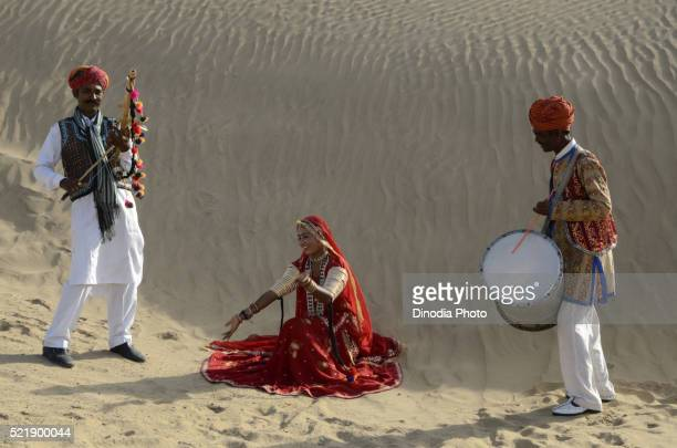 Folk musicians on sand dune in Jaisalmer at Rajasthan, India
