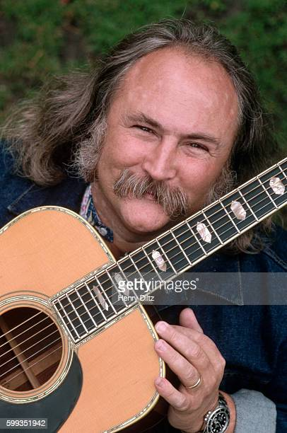 Folk rock singer David Crosby holding a guitar Crosby became well known in the Byrds then moved on to Crosby Stills and Nash CSN collaborated with...