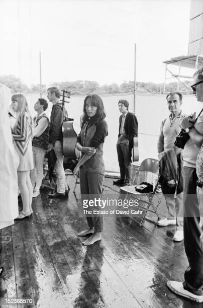 Folk singer and activist Joan Baez backstage at the Newport Folk Festival in July 1967 in Newport Rhode Island Sharing the backstage area with Ms...