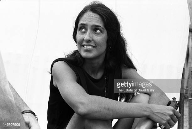 Folk singer and activist Joan Baez poses for a portrait backstage at the Newport Folk Festival in July 1965 in Newport Rhode Island
