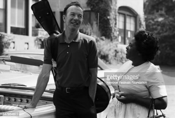Folk singer and activist Pete Seeger and gospel singer Fannie Lou Hamer backstage at the Newport Folk Festival in July 1965 in Newport Rhode Island
