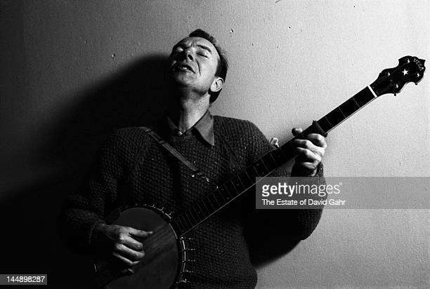 Folk singer and musician songwriter and environmental activist Pete Seeger poses for a portrait with his banjo in April 1962 in New York City New York