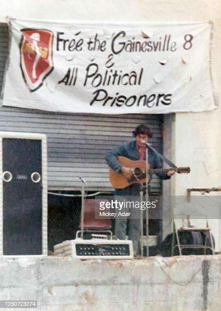 Folk singer and political activist Phil Ochs performs in support of the Gainesville 8 at a benefit concert in the Gainesville Sun newspaper parking...