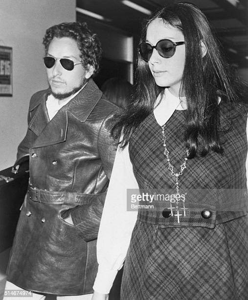 Folk singer Bob Dylan and his wife leaving London after performing at the Isle of Wight festival. Dylan's wife is expecting a child.