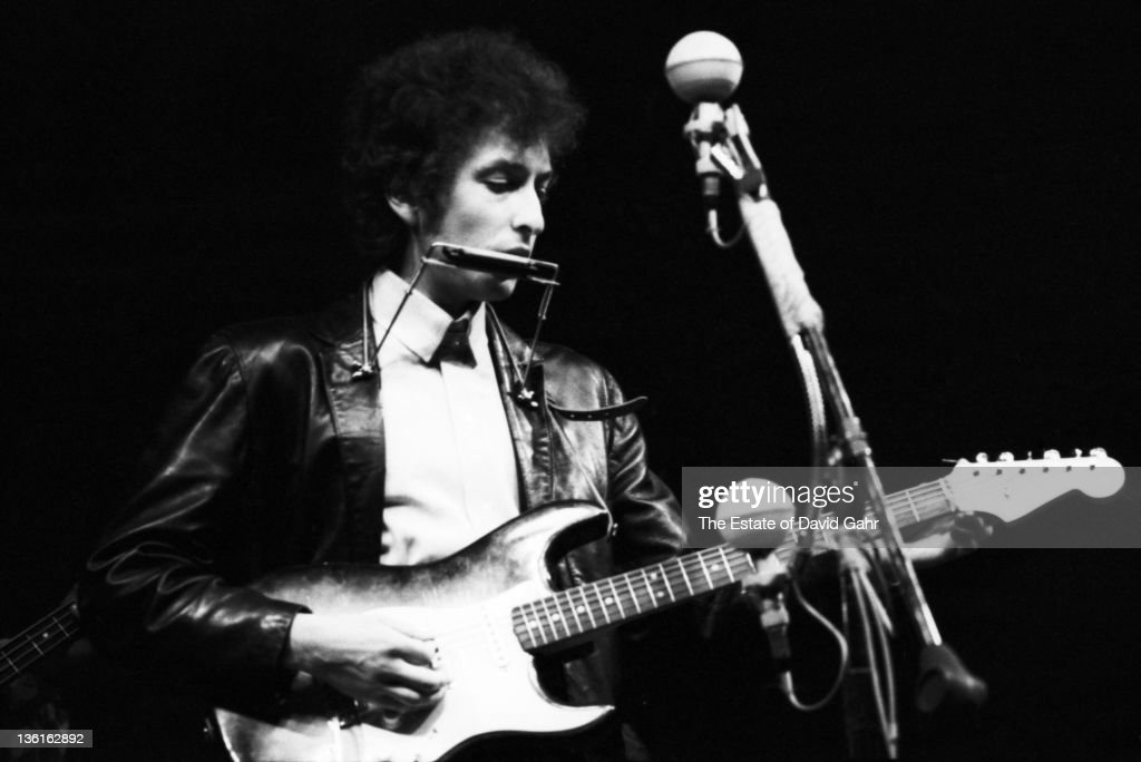 Folk singer Bob Dylan goes electric at the Newport Folk Festival on July 25, 1965 in Newport, Rhode Island.