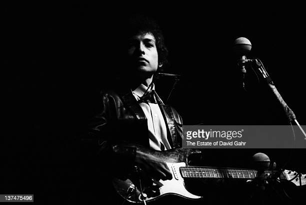 Folk singer Bob Dylan goes electric at the Newport Folk Festival on July 25 1965 in Newport Rhode Island