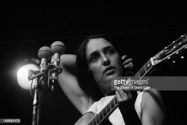 Folk singer Joan Baez performs at the Newport Folk Festival in July 1963 in Newport Rhode Island