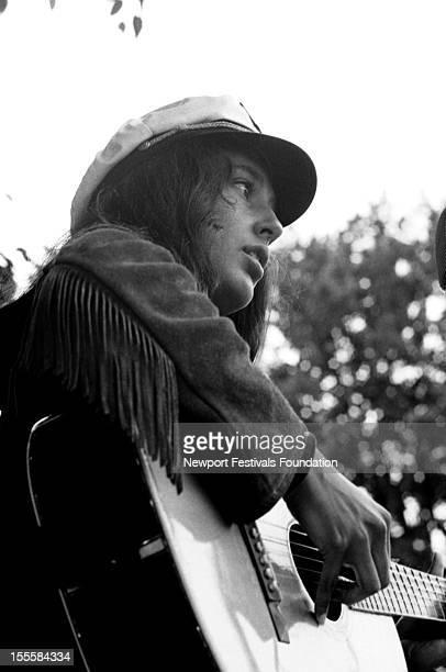 Folk singer Joan Baez performs at the Newport Folk Festival in July 1964 in Newport Rhode Island
