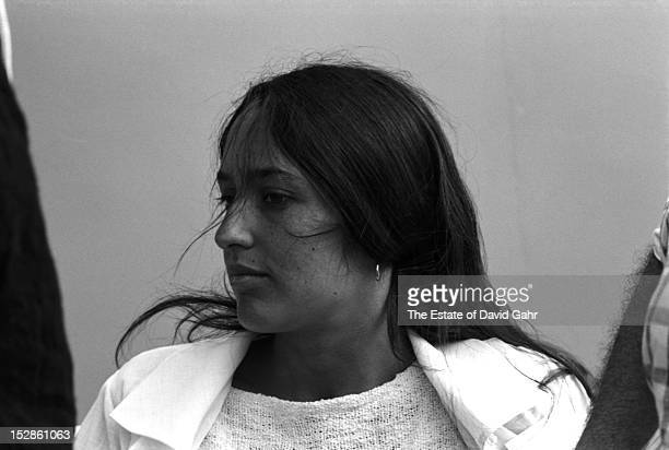Folk singer Joan Baez poses for a portrait backstage at the Newport Folk Festival in July 1965 in Newport Rhode Island