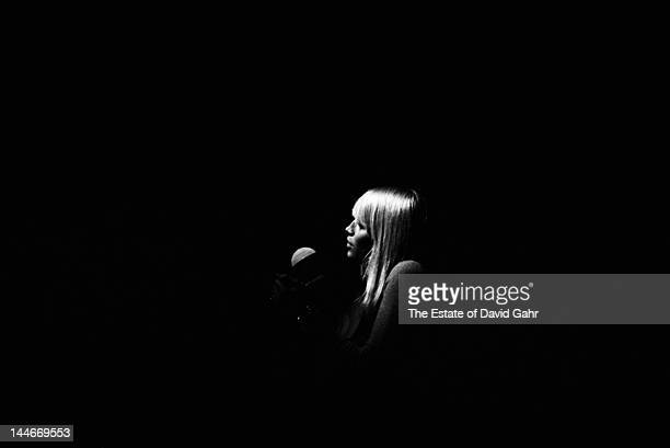 Folk singer Mary Travers of the folk trio Peter Paul and Mary performs at the Newport Folk Festival in July 1964 in Newport Rhode Island