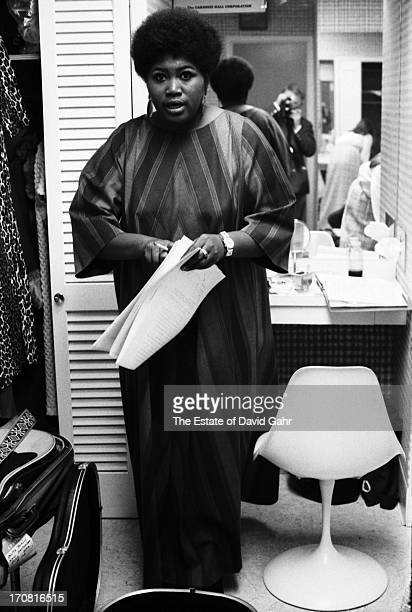 Folk singer Odetta poses for a portrait backstage before performing at the Woody Guthrie Memorial Concert at Carnegie Hall on January 20th 1968 in...