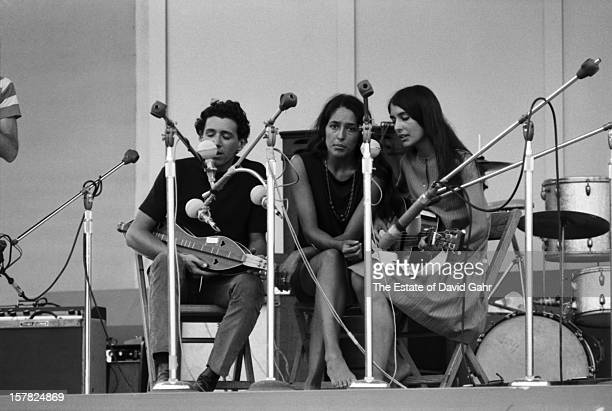 Folk singer Richard Farina and folk singers and sisters Joan Baez and Mimi Farina perform at the Newport Folk Festival in July 1965 in Newport Rhode...