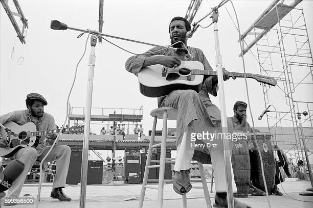 Folk singer Richie Havens performs for the masses at the free Woodstock Music and Art Fair The festival took place on Max Yasgur's dairy farm which...