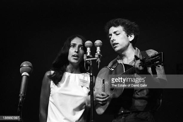 Folk singers Bob Dylan and Joan Baez perform at the Newport Folk Festival in July 1963 in Newport Rhode Island
