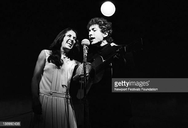 Folk singers Bob Dylan and Joan Baez perform at the Newport Folk Festival in July 1964 in Newport Rhode Island