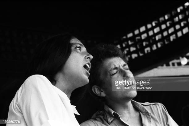 Folk singers Bob Dylan and Joan Baez perform at the Newport Folk Festival in July 1963 in Newport Rhode Island