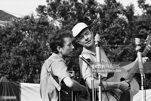 Folk singers Bob Dylan and Pete Seeger perform together at the Newport Folk Festival in July 1963 in Newport Rhode Island