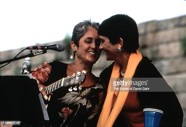 Folk singers Joan Baez and her sister Mimi Farina perform at the Newport Folk Festival in July 1985 in Newport Rhode Island