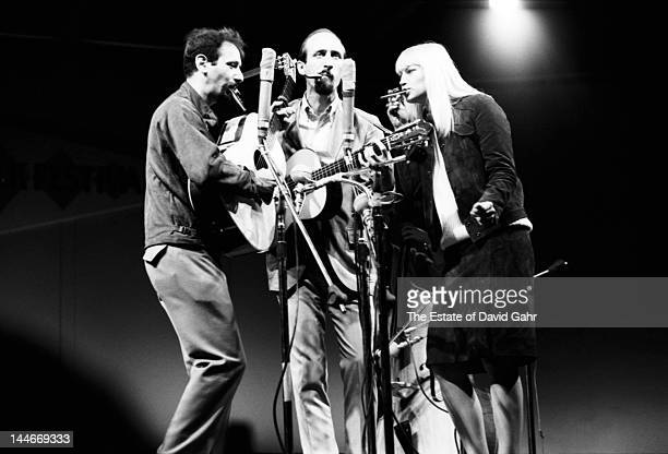 Folk trio Peter Paul and Mary perform at the Newport Folk Festival in July 1965 in Newport Rhode Island