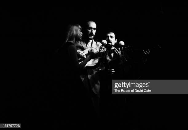 Folk trio Peter Paul and Mary perform at the Newport Folk Festival in July 1964 in Newport Rhode Island