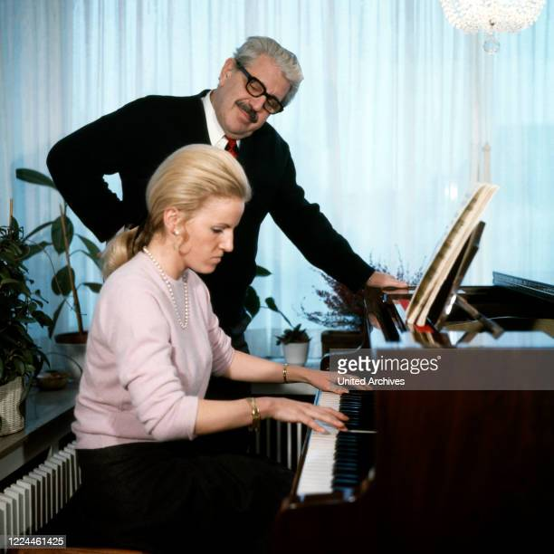 Folklore actor Willy Millowitsch watching daughter Katarina playing the grand piano at Cologne, Germany, 1973.