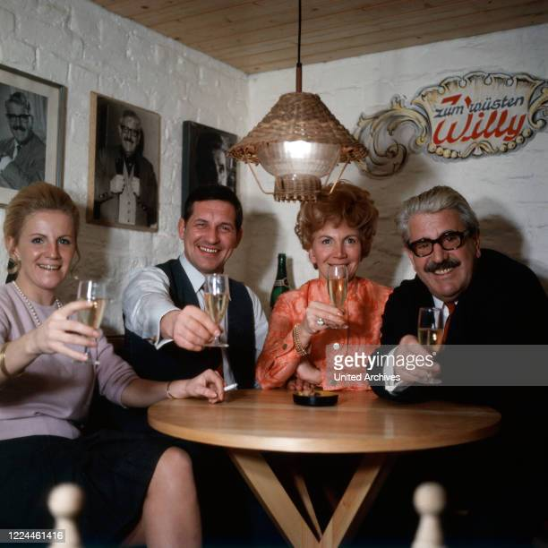 Folklore actor Willy Millowitsch with his wife Gerda and daughter Katarina at their home in Cologne, Germany, 1973.