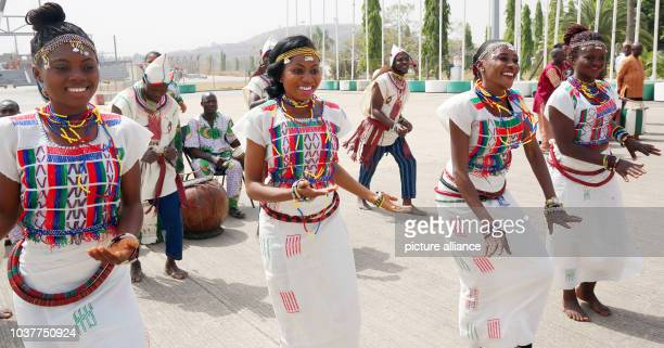A folklore group greets German President Joachim Gauck at the airport of Abuja Nigeria 10 February 2016 Gauck is on a fiveday state visit to Nigeria...