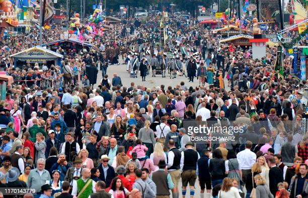 Folklore groups parade over the Theresienwiese fair grounds at the Oktoberfest beer festival in Munich, southern Germany, on September 22, 2019. -...