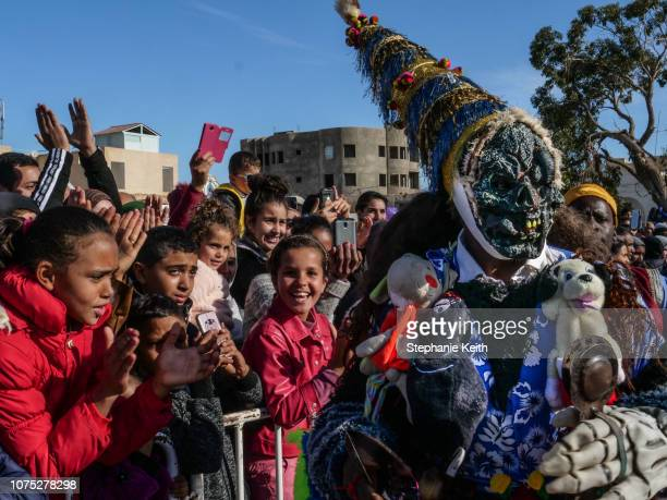 A folkloric music group performs in the center of town called the souk on the first day of the festival on December 20 2018 in Douz Tunisia The...