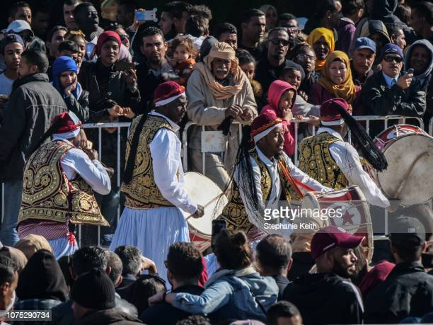 A folkloric music group performs in the center of town during the Sahara Festival on December 23 2018 in Douz Tunisia The Sahara Festival in its 51st...
