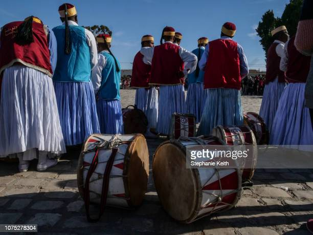 A folkloric music group waits to perform in the center of town called the souk on the first day of the festival on December 20 2018 in Douz Tunisia...