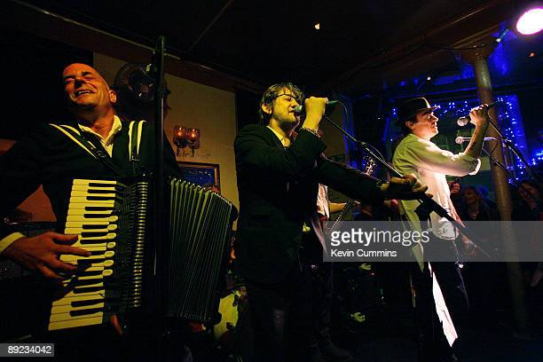 Folkpunk group The Pogues performing at The Boogaloo pub Archway London 23rd July 2009 Left to right accordion player James Fearnley singer Shane...