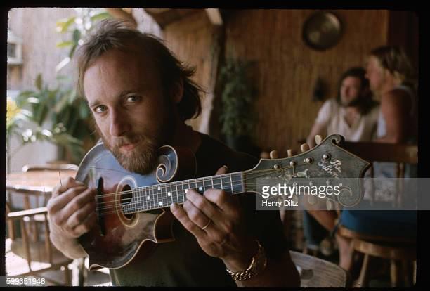 Folkrock singer Stephen Stills plays a mandolin in Maui Stills became wellknown in Buffalo Springfield then moved on to Crosby Stills and Nash CSN...