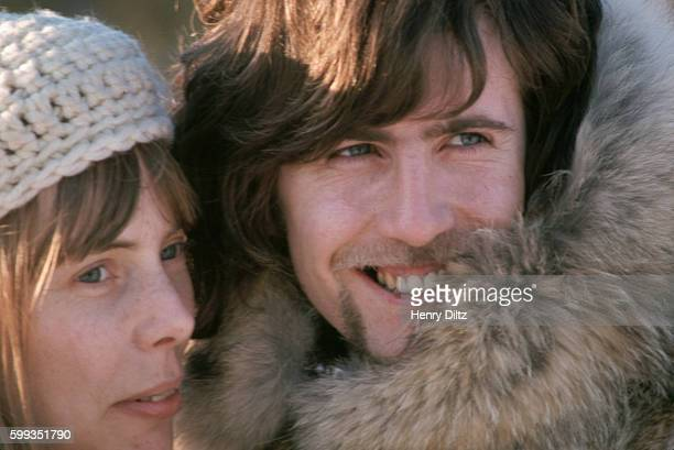 Folkrock singers Joni Mitchell and Graham Nash wear fur parkas Crosby Stills and Nash often covered songs by and associated with Joni Mitchell CSN...