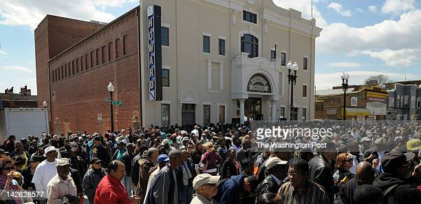 Folks are seen enjoying the afternoon outside the Howard Theatre during the official opening on April 9 2012 in Washington DC The community day event...