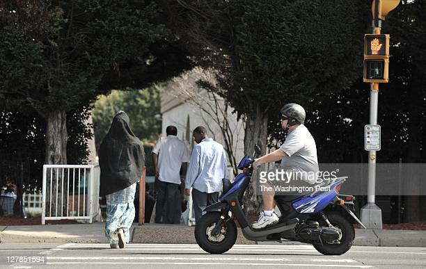 Folks cross Route 7 en route to Dar alHijrah Mosque before midday Friday prayers on September 30 in Falls Church VA USborn alQaeda leader Anwar...