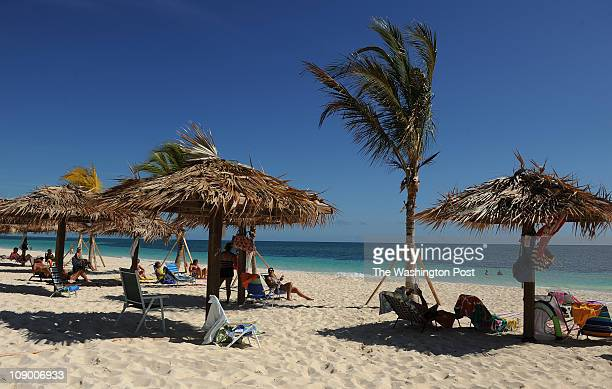 Folks enjoy the afternoon sun at Coral Beach on February 6 2011 in Freeport Bahamas