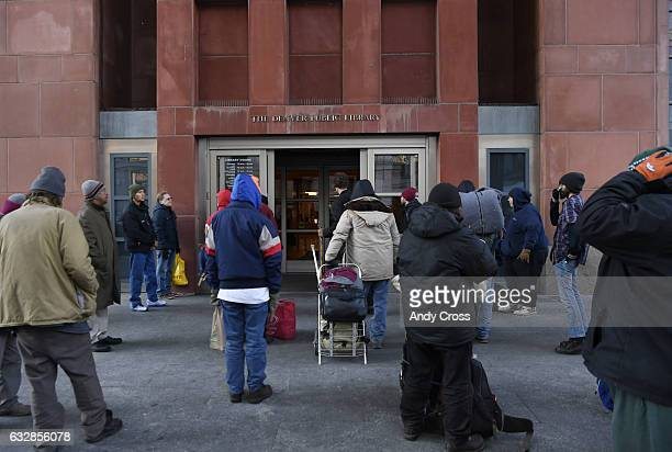 Folks mostly homeless men and women line up and wait to enter the Denver Central Library to warm up and to use their resources January 26 2017
