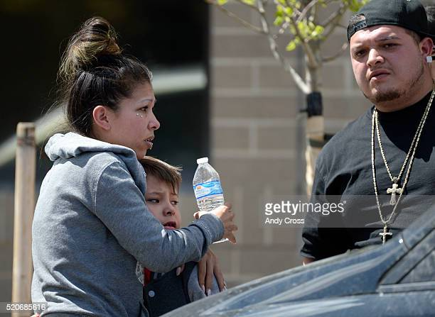 Folks visibly upset at the scene of an officer involved shooting on Bannock St between 13th and 14th st April 12 2016