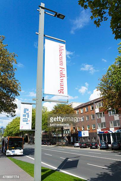 folkwang museum banners in bismarck street essen - pole stock pictures, royalty-free photos & images