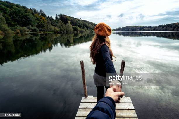 folllow me shot at an austrian lake - following stock pictures, royalty-free photos & images