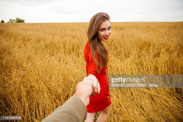 Follow Me, Beautiful Sexy Young Woman Holds The Hand Of A Man In