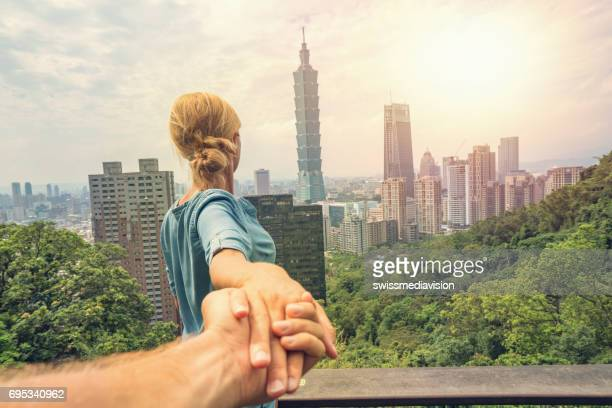 Follow me concept - Couple traveling in Asia