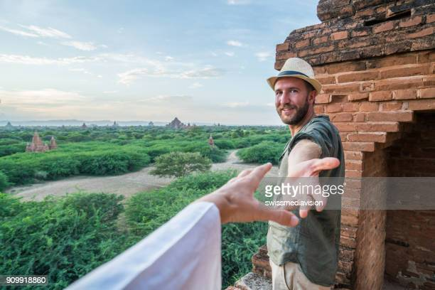 Follow me to concept, man leading girlfriend to Bagan temples at sunrise, Myanmar