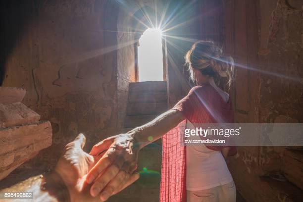 Follow me to concept, woman leading boyfriend inside Bagan ancient temple, Myanmar
