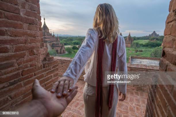 Follow me to concept, woman leading boyfriend to Bagan temples at sunrise, Myanmar